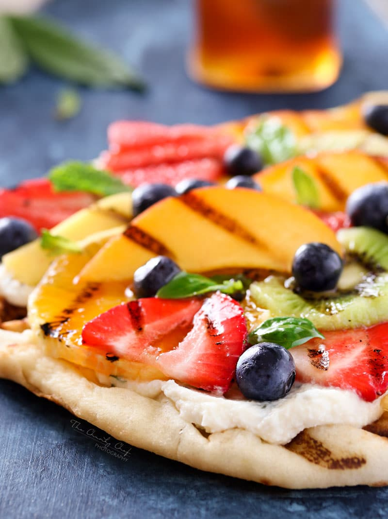 Grilled Fruit Pizza | Flatbread slathered with a glorious honey herb whipped ricotta, topped with delicious grilled fruit, drizzled with honey and sprinkled with fresh herbs! | http://thechunkychef.com