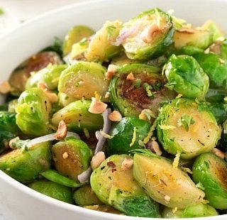 Brussels sprouts with Toasted Hazelnut Butter | Braised brussels sprouts and shallots are tossed with a savory toasted hazelnut and herb butter and ready to hit your table in less than 30 minutes! | http://thechunkychef.com