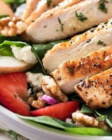 Grilled Chicken Strawberry Spinach Salad | This strawberry spinach salad is full of walnuts, fruits, cheeses, topped with juicy grilled chicken and a homemade honey herb vinaigrette! | http://thechunkychef.com