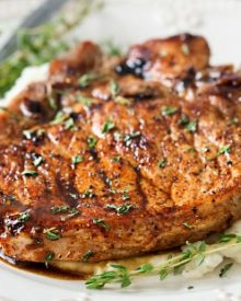 Maple Balsamic Glazed Pork Chops | Tender, juicy, bone-in glazed pork chops are seared and coated in a lip-smacking maple balsamic vinegar sauce! | http://thechunkychef.com