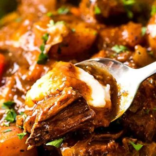 This comfort food is the King of all Irish beef stews, with the Guinness and coffee flavors melding perfectly to give way to a deep, rich, lusciously savory sauce that simmers away to tenderize the beef and vegetables until they're spoonable! #beefstew #irish #stpatricksday #stew #beef #guinness #coffee #slowcooker #crockpot #instantpot #pressurecooker