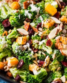 The ultimate broccoli salad is made with crunchy almonds, bacon, sunflower seeds, tart cranberries, and a creamy citrus poppyseed dressing!  Perfect make-ahead holiday side dish recipe! #sidedish #broccoli #salad #easter #memorialday #summer #easyrecipe #makeahead