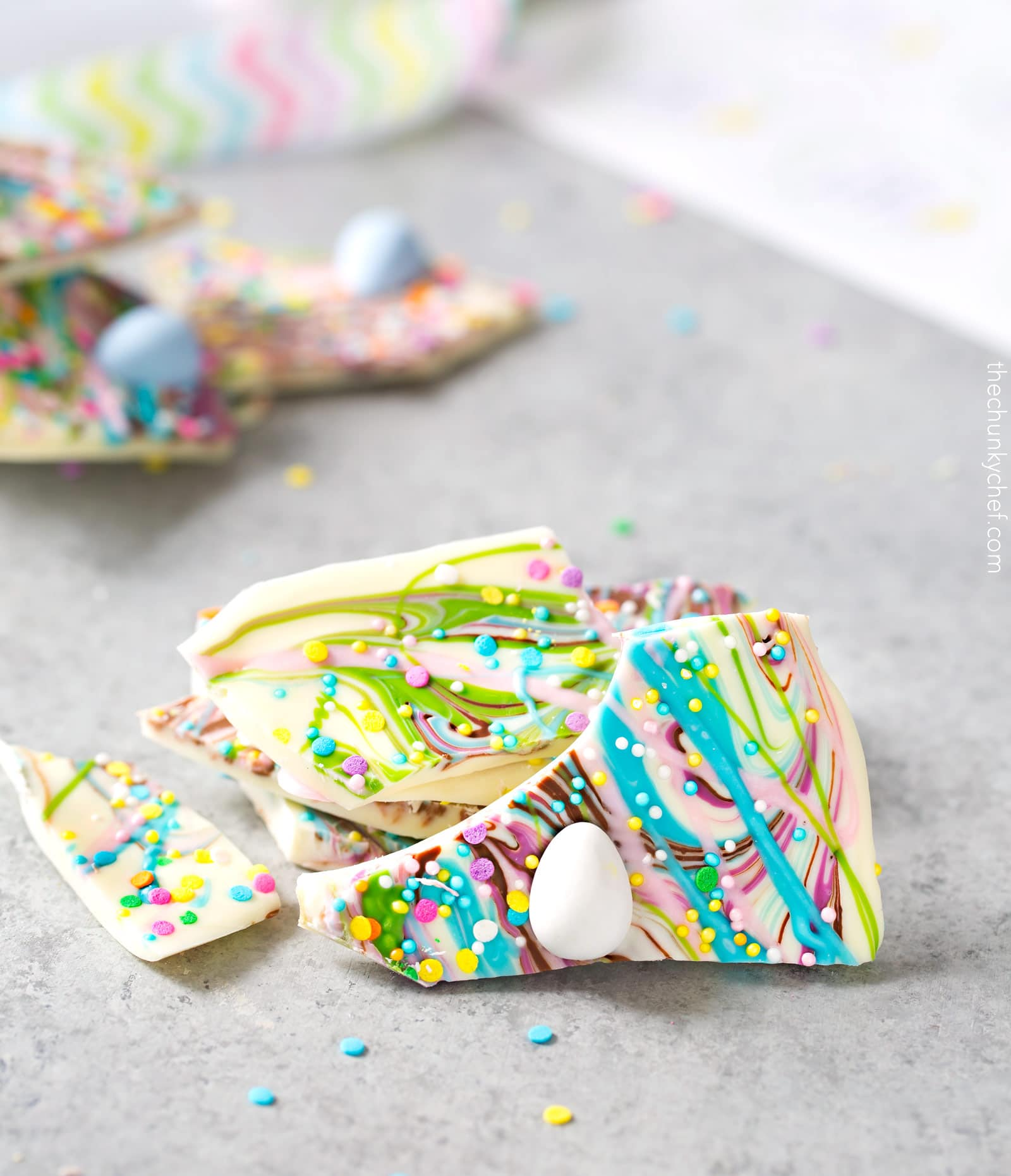 Brownie Batter White Chocolate Bark | A fun no bake bark dessert, made with white chocolate swirled together with milk chocolate brownie batter, and decorated in fun Spring colors! Easily customizable to any holiday and makes a great homemade gift! | http://thechunkychef.com