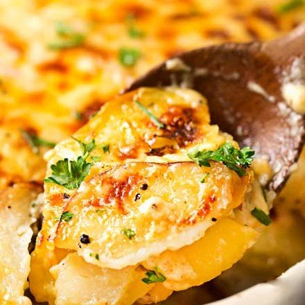 Velvety soft and tender layers of two kinds of potatoes, smothered in a rich 3 cheese garlic sauce, then topped with extra cheese for a perfectly crispy top! It's the scalloped potato dish you've been dreaming of your entire life! #scallopedpotatoes #potato #sidedish #holiday #Easter #cheese #potatoesaugratin #augratin #makeahead