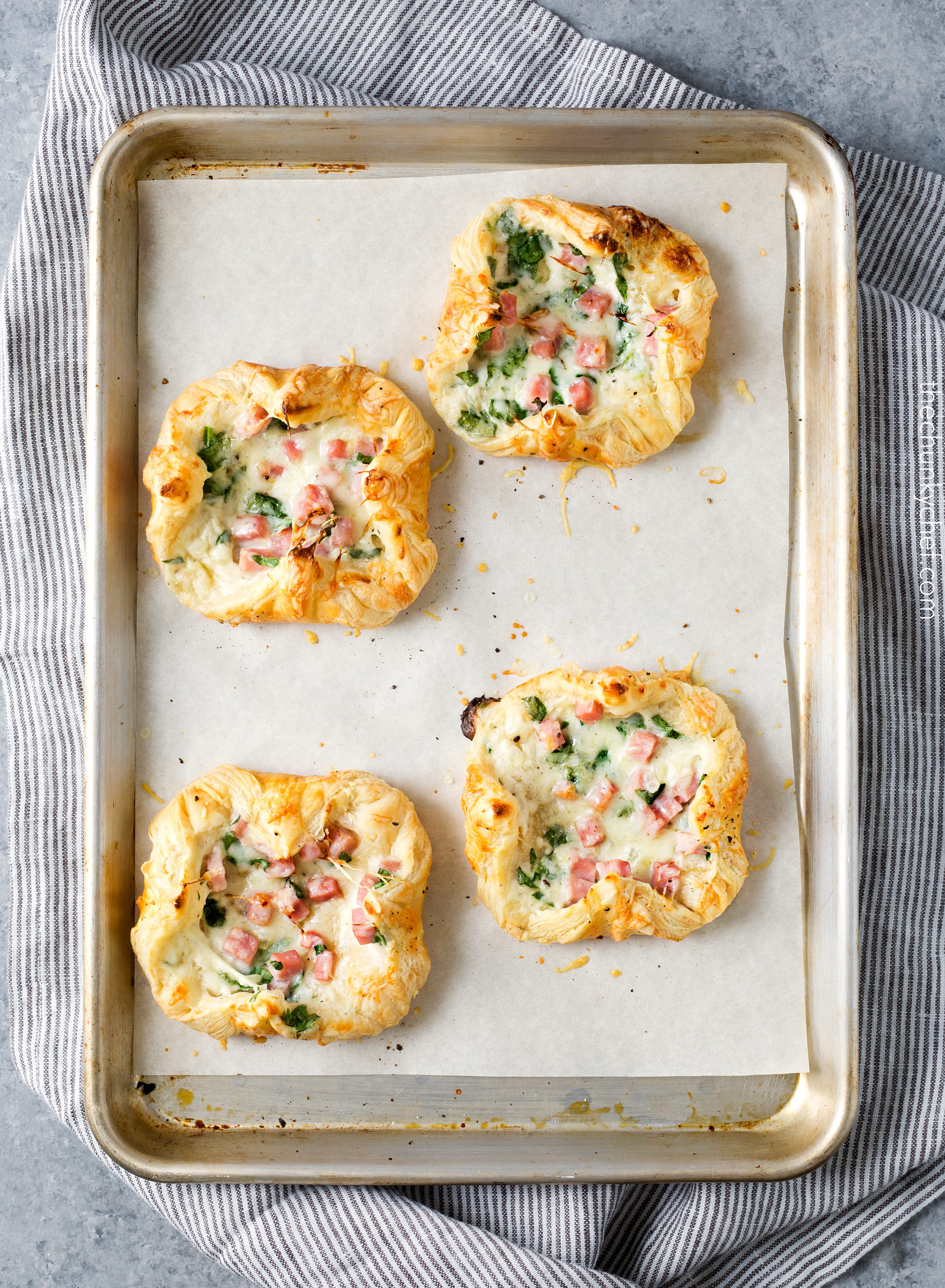 Ham and Cheese Spinach Puffs   Ready in just over 30 minutes, these spinach puffs are made with flaky puff pastry, wrapped around a creamy mixture of ham, gruyere cheese and fresh spinach. Perfect for using leftover ham!   http://thechunkychef.com