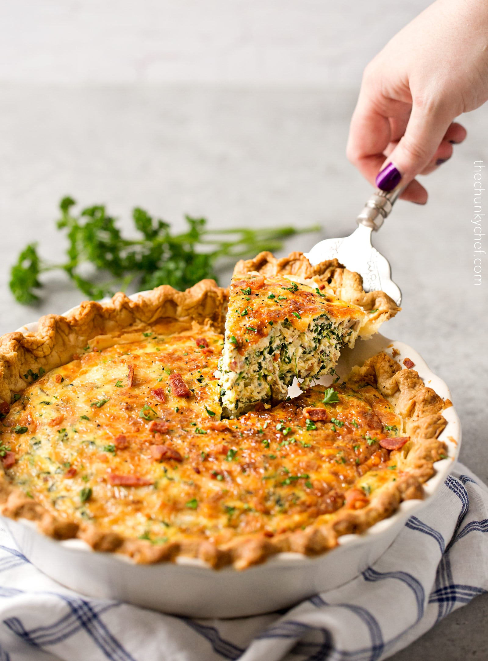 Basic Cheesy Spinach Quiche with Bacon | This easy quiche is loaded with spinach, ham, bacon, caramelized onions, mushrooms and Gruyere! No complicated dinner here, it uses frozen pie crust! | http://thechunkychef.com