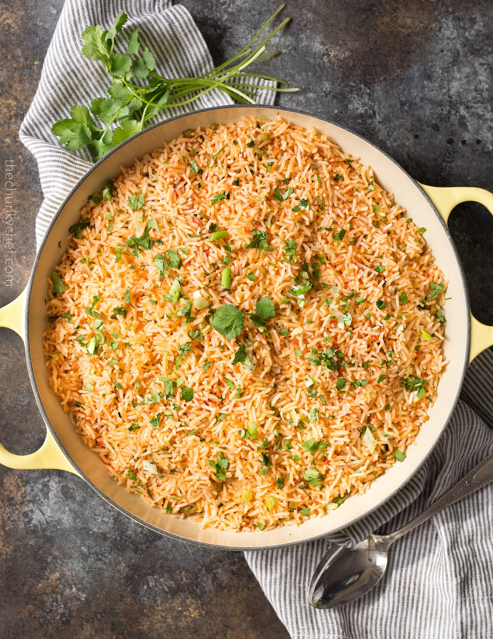 Easy Baked Mexican Rice | This foolproof method for cooking rice tastes just like the rice from your favorite Mexican restaurant... full of flavor and cooked to perfectly fluffy perfection! | http://thechunkychef.com