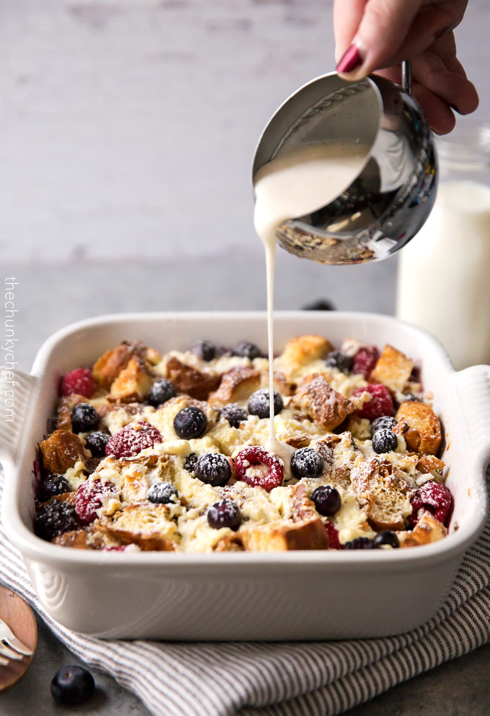 Mixed Berry Overnight Croissant Breakfast Bake | Whip this croissant breakfast bake up the night before, let it sit overnight, then bake it to crispy yet creamy perfection. Drizzle it with vanilla bean glaze and prepare to fall in love! | http://thechunkychef.com