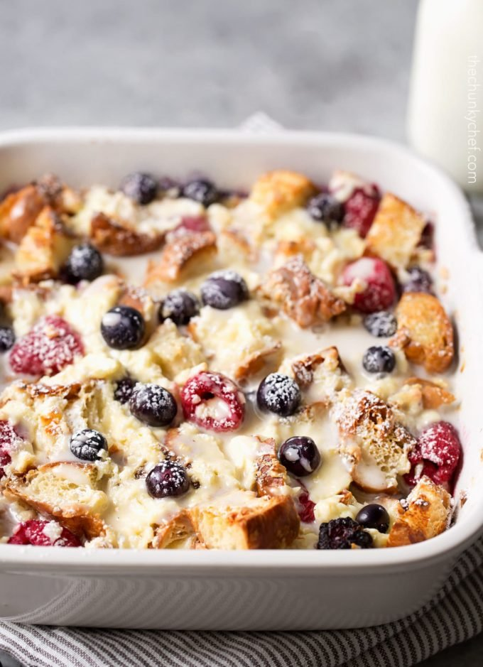 berry croissant bake in baking dish with glaze