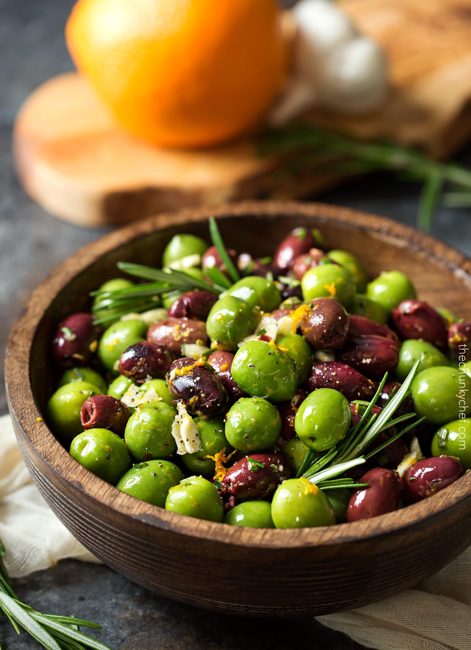 Easy Citrus Herb Marinated Olives | Kalamata and Castelvetrano olives are marinated in a mouthwatering marinade of citrus, herbs and garlic. Perfect for a snack, party, or cheese platter! | http://thechunkychef.com