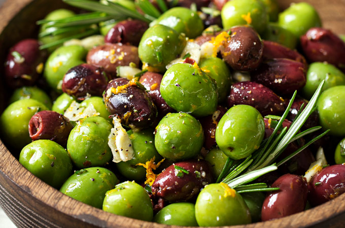 Easy Citrus Herb Marinated Olives | Kalamata and Casteltravano olives are marinated in a mouthwatering marinade of citrus, herbs and garlic. Perfect for a snack, party, or cheese platter! | http://thechunkychef.com