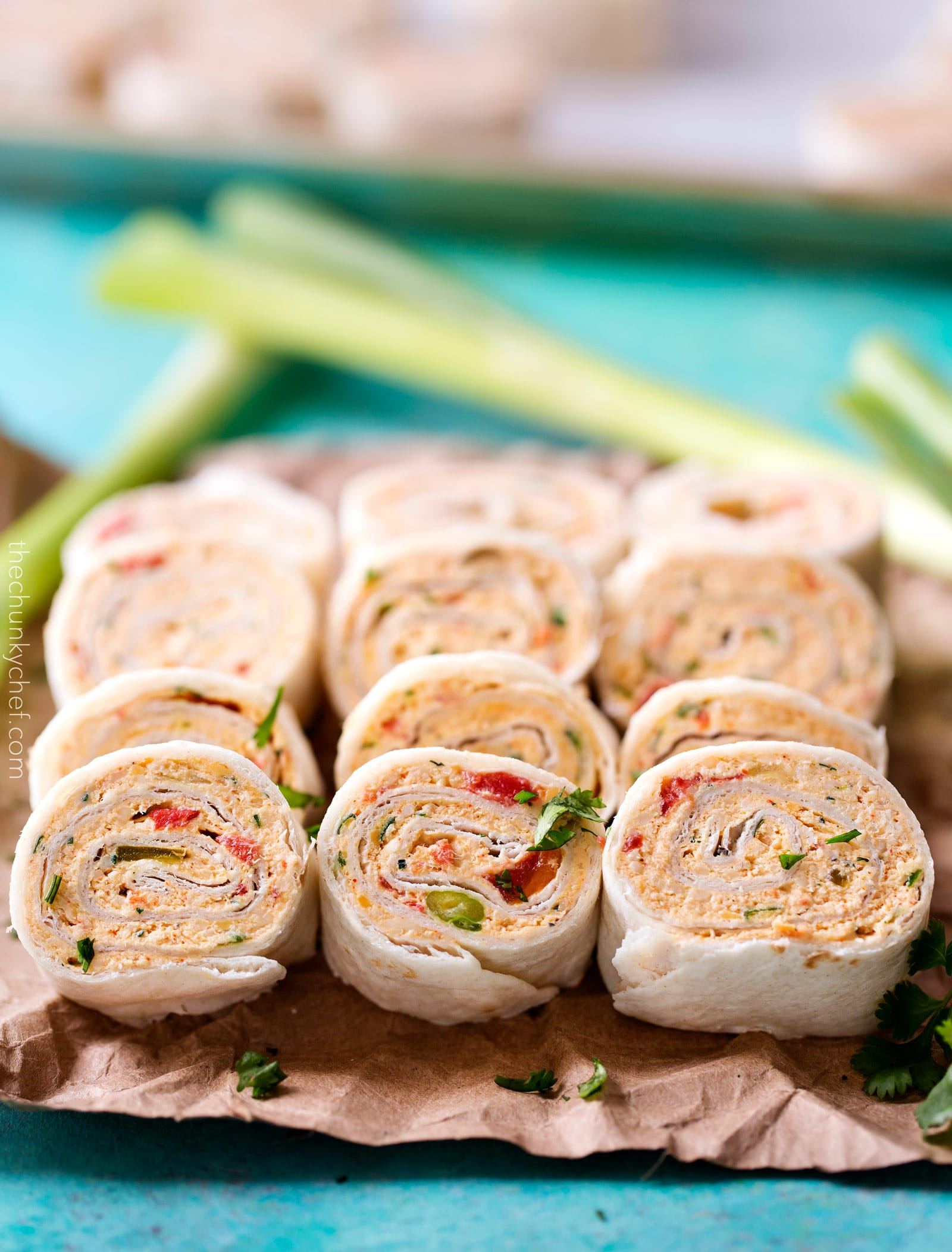 Chicken Taco Mexican Pinwheels | These pinwheels are filled with a creamy chicken taco filling, which is easily customizable, and rolled up to make a perfect appetizer or party food! | http://thechunkychef.com