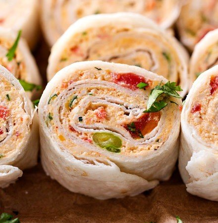 Chicken Taco Mexican Pinwheels   These pinwheels are filled with a creamy chicken taco filling, which is easily customizable, and rolled up to make a perfect appetizer or party food!   http://thechunkychef.com