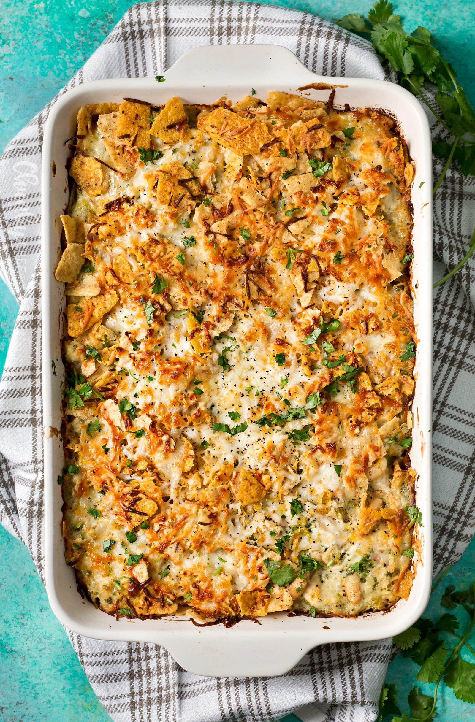 Cheesy Chicken Tortilla Casserole   A rotisserie chicken, creamy salsa verde sauce, plenty of gooey cheese and crunchy tortilla chips... it's the perfect casserole that's easy to prep ahead for a weeknight dinner!   http://thechunkychef.com