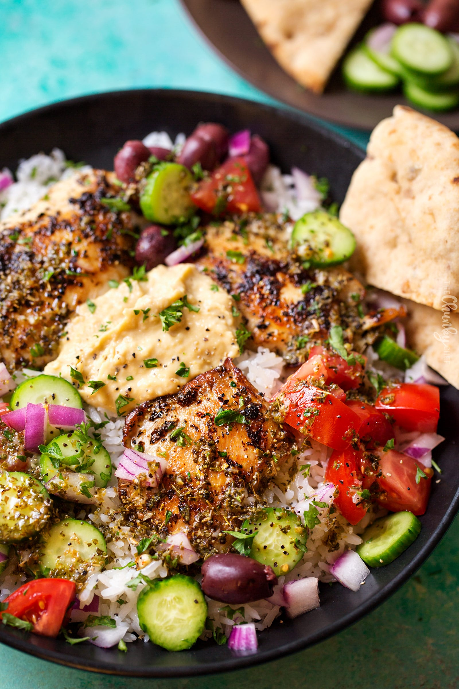 Hearty Greek Chicken and Rice Bowl | Ready in just 20 minutes or less, this rice bowl is packed with great Greek and Mediterranean flavors!  It's also perfect for meal prep or a back to school lunch box idea! | http://thechunkychef.com