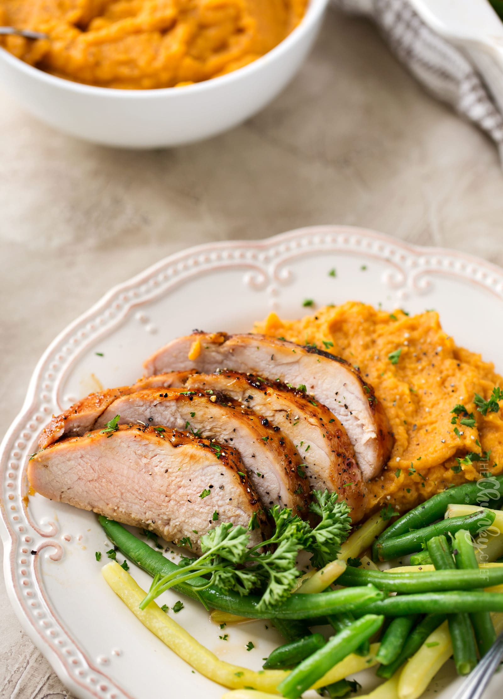 Ginger Honey Roasted Pork Tenderloin | Perfect for a busy weeknight, this pork tenderloin is loaded with amazing flavors and ready in less than 30 minutes! | https://thechunkychef.com | #dinner #pork #roasted #easyrecipe
