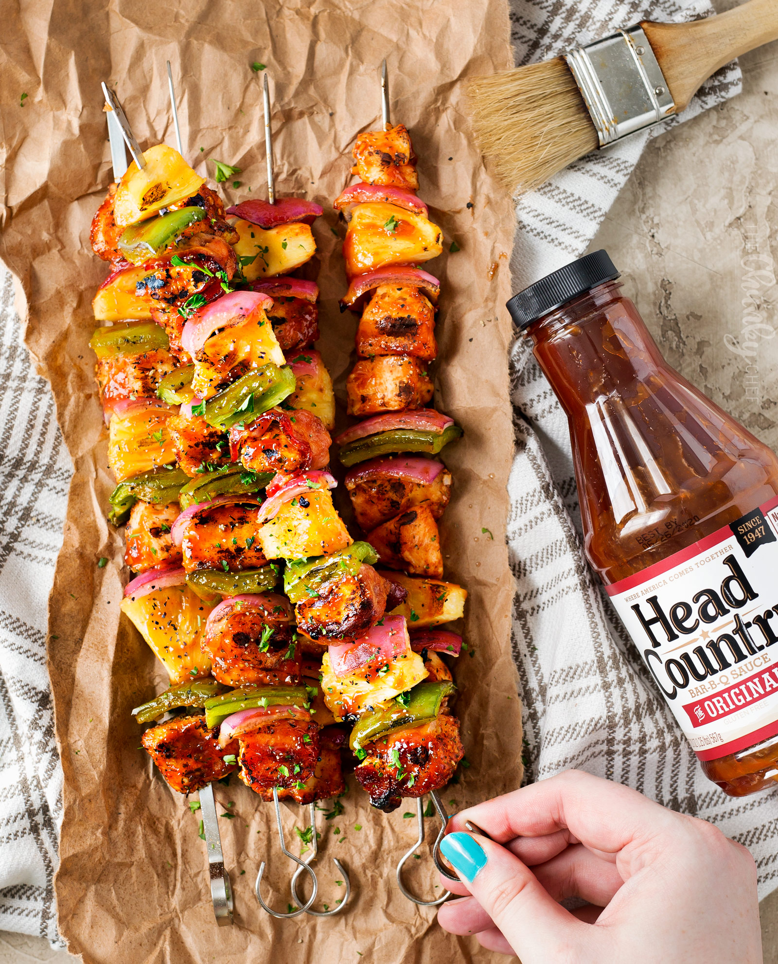 Grilled BBQ Chicken Kabobs | These chicken kabobs are loaded with flavor, from the homemade spice rub, to the perfect bbq sauce they're basted with.  Plus, tips for how to skewer bacon, and how to cook these kabobs when grilling isn't an option. | http://thechunkychef.com | chicken | kabob| kebab | skewer | bbq | easy | grilled | summer