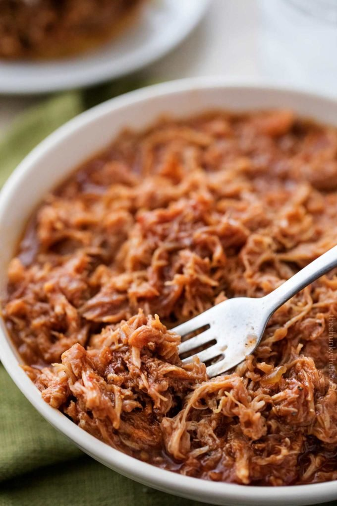 The most incredibly tender pulled pork, made easily in an hour in the Instant Pot!  With just 4 ingredients, it's perfect to throw together for dinner with minimal effort!