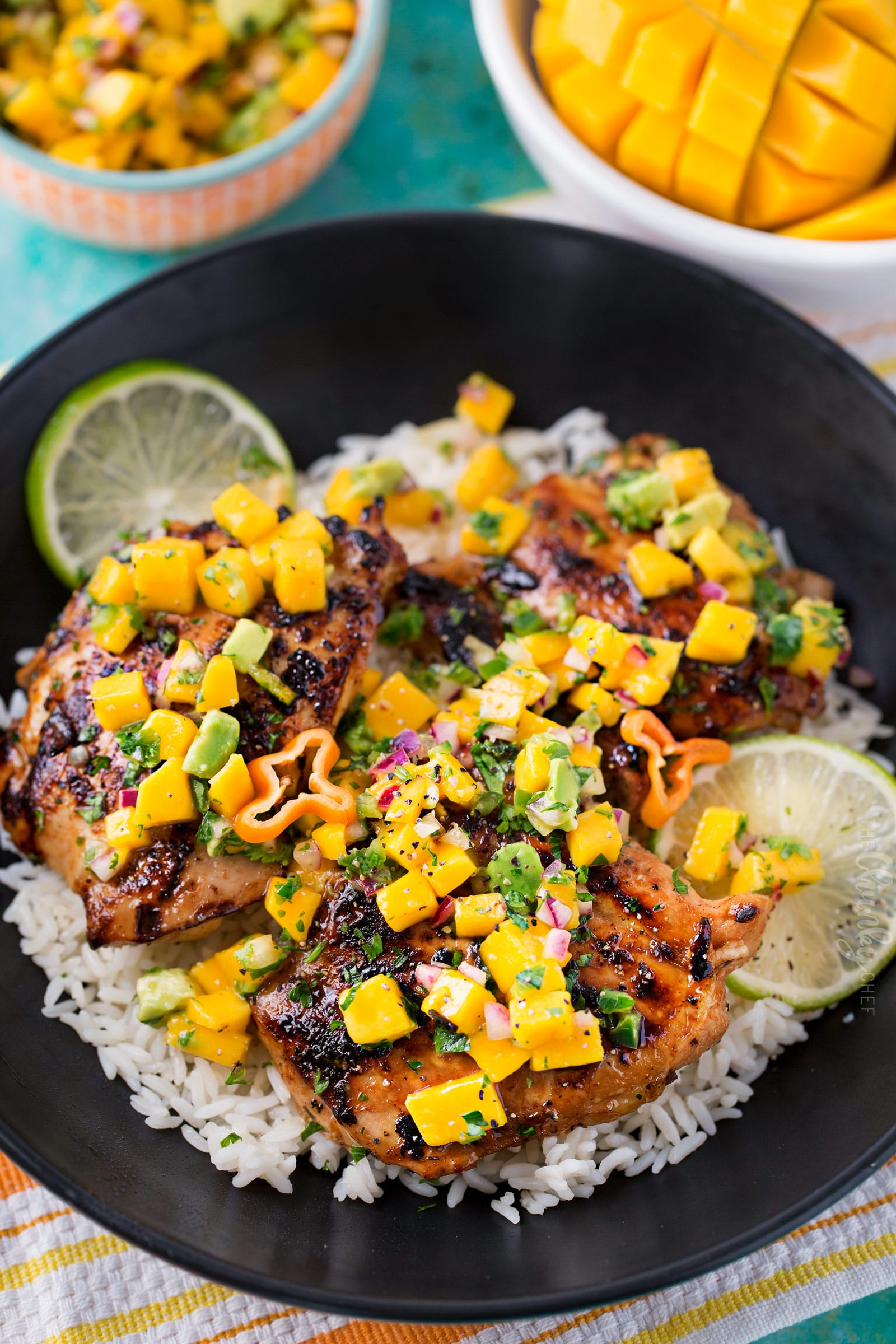 Jerk Chicken Thighs with Avocado Mango Salsa | Perfect for a busy weeknight, this chicken recipe comes together quickly and tastes amazing!  The avocado mango salsa is nutritious and phenomenal on the chicken, or with chips! | https://thechunkychef.com