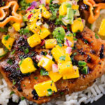 Jerk Chicken Thighs with Avocado Mango Salsa