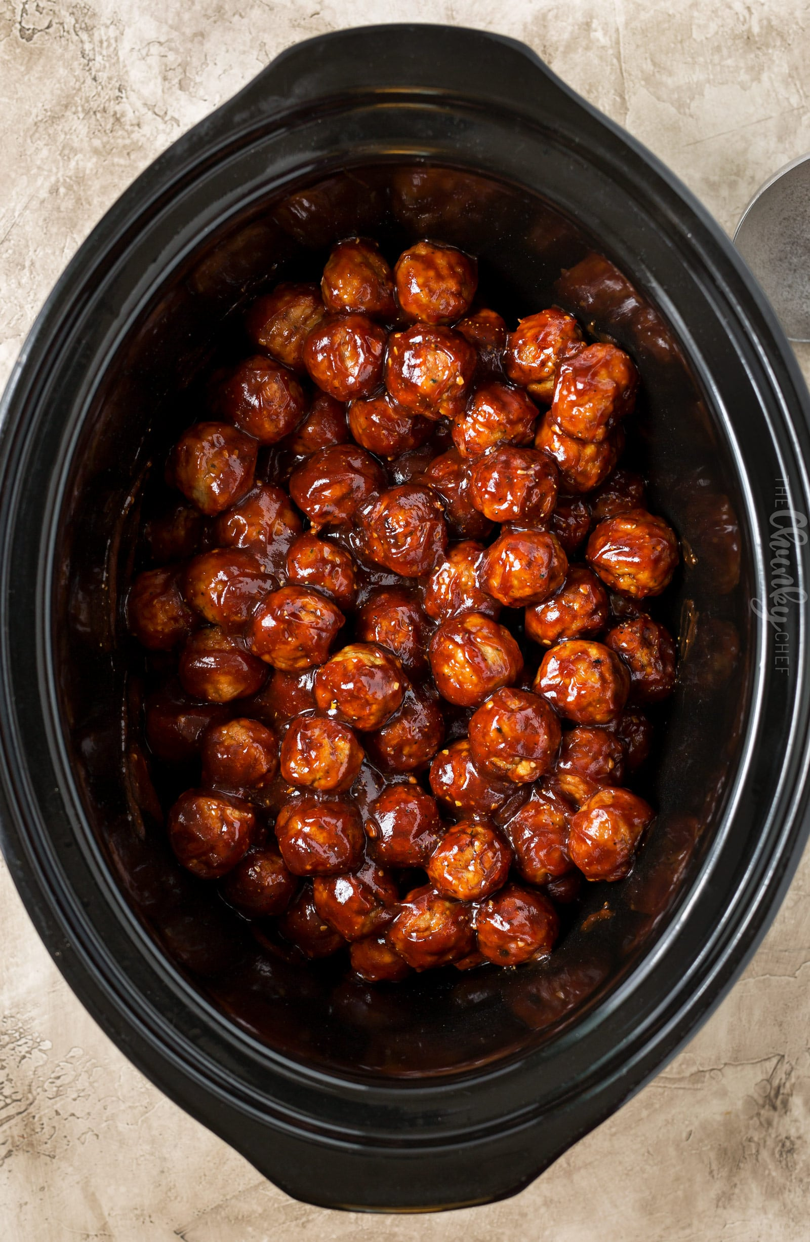 Cranberry BBQ Crockpot Meatballs | The perfect appetizer for a party or game day... with just 3 ingredients and just 5 minutes of prep!  Pop it all in your slow cooker and enjoy! | https://www.thechunkychef.com | #appetizer #meatballs #party #easyrecipe #crockpot #slowcooker