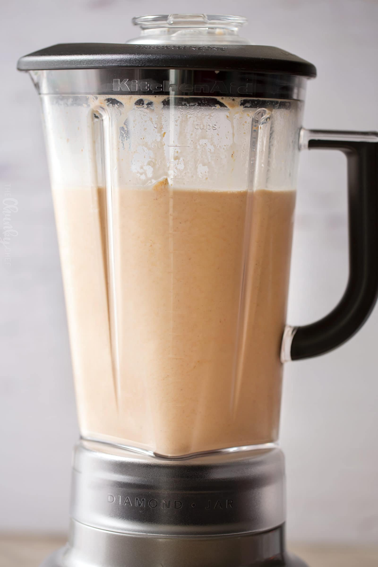 Pumpkin Spice Latte Milkshake | Made with all the great pumpkin spice latte flavors, this milkshake hits both the Fall and Summer tastebuds, and will soon be your new favorite way to enjoy the pumpkin spice flavor! | https://www.thechunkychef.com | #milkshake #pumpkin #pumpkinspice #latte #frozen