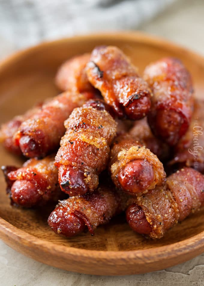 Plate of bacon wrapped little smokies (cocktail sausages)