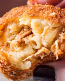 BBQ Pulled Pork Fried Mac and Cheese Bites | 5 cheese homemade Mac and cheese, slow cooker bbq pulled pork, combined and breaded in crispy spiced panko and fried until perfectly golden! | https://thechunkychef.com | #appetizer #gameday #tailgating #friedmacandcheese #pulledpork