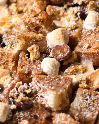 Overnight S'mores French Toast Casserole | Perfect for a holiday breakfast or brunch, sourdough bread is mixed with chocolate chips, marshmallows and graham crackers, then baked up into pure French toast perfection! | https://thechunkychef.com | #frenchtoast #breakfast #brunch #casserole