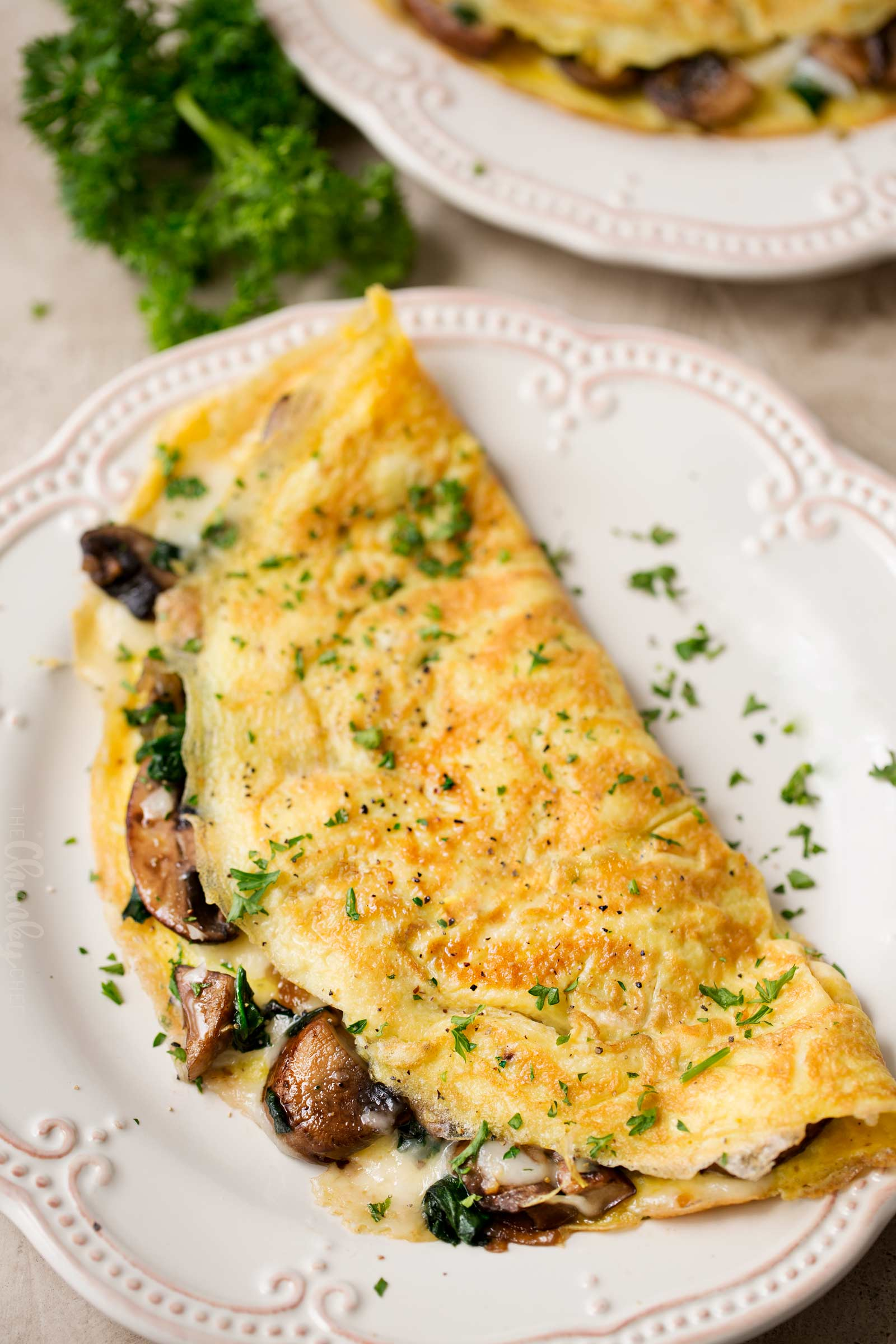 Cheesy mushroom omelet on plate