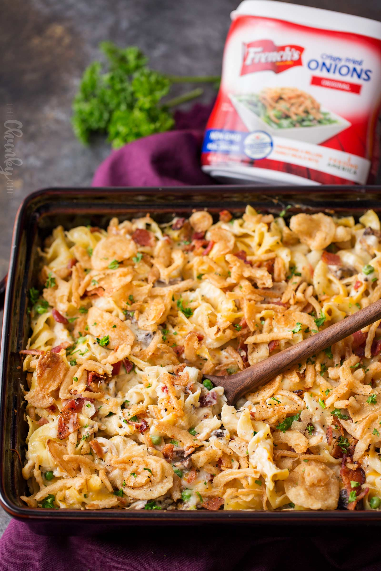 Loaded Cheesy Chicken Noodle Casserole | This chicken noodle casserole has great classic chicken noodle flavors, with some added flavors like bacon, mushrooms, and a crunchy fried onion topping!  Great for a make-ahead meal, this casserole will be family favorite! | The Chunky Chef | #chickennoodle #chickencasserole #casserole #makeahead #comfortfoods #weeknightmeals
