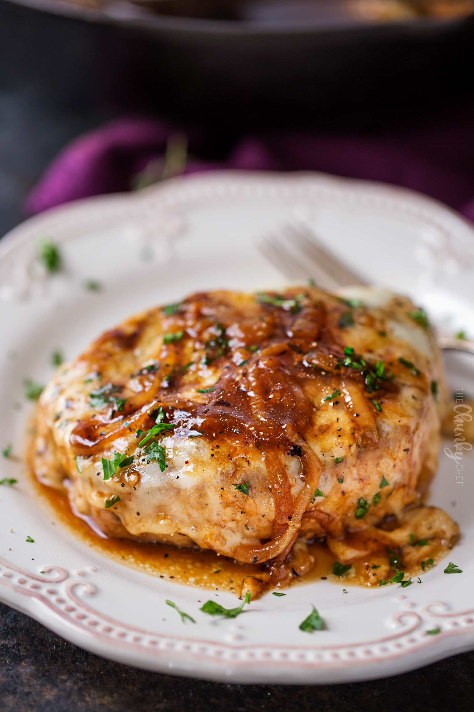 Smothered pork chop on plate