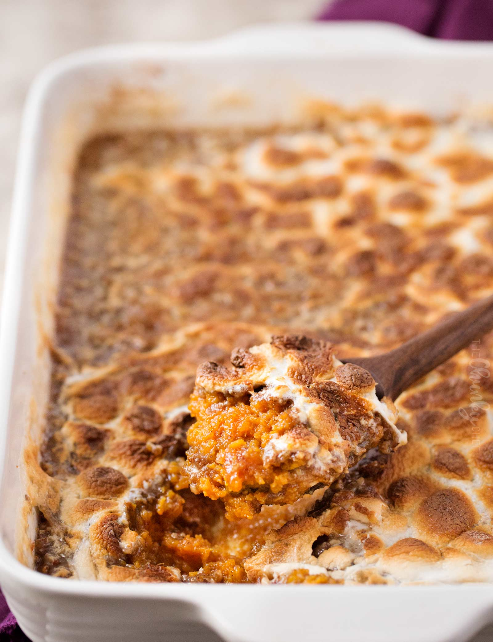 Spiced Sweet Potato Casserole | Mashed sweet potatoes are spiced with warm Fall spices, then topped with a crunchy pecan crumble and gooey marshmallows.  Perfect for Thanksgiving or any holiday! | The Chunky Chef | #sweetpotato #sweetpotatocasserole #Thanksgivingrecipe #sidedish #casserolerecipe #holidayrecipe