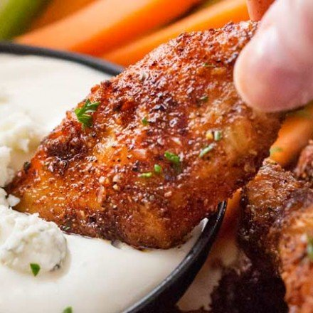 Epic Dry-Rubbed Baked Chicken Wings | Extremely tender and juicy, these baked chicken wings are rubbed with the most epic dry rub made right from your spice cabinet! You won't miss the deep fryer or the sauce, I guarantee it!! | The Chunky Chef | #chickenwings #chickenwingrecipes #bakedhotwings #bakedwings #dryrub #gamedayfood #partyfood