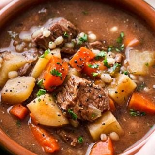 Hearty and positively soul-warming, this beef barley soup simmers all day in the slow cooker, which makes for an incredibly rich soup recipe! #beefbarley #soup #slowcooker #crockpot #comfortfood #barley #beefsoup #easyrecipe #dinner
