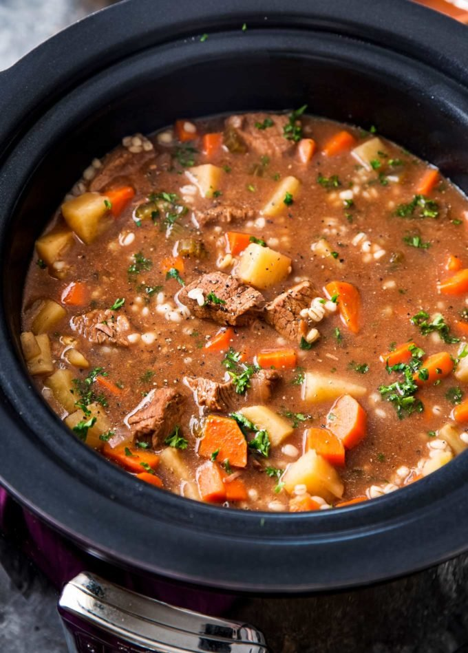 Slow cooker full of beef barley soup recipe