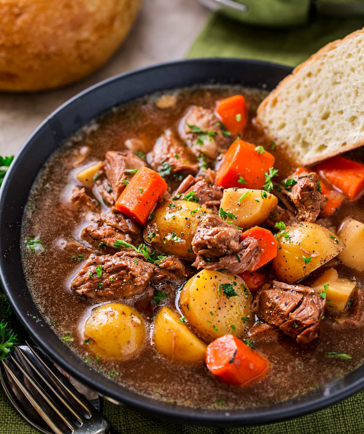 Crockpot Beef Stew with beer and horseradish in a bowl with bread