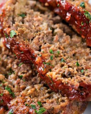 Glazed Chipotle Meatloaf Recipe | Not your average meatloaf recipe, this glazed chipotle meatloaf is packed with bold flavors like chipotle peppers, pepper jack cheese, chili powder and cumin!  Slow cooker instructions too! | The Chunky Chef | #meatloaf #beefrecipes #groundbeefrecipes #chipotle #spicy #comfortfood #meatloafrecipe