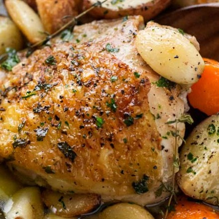 One Pan Roasted Chicken and 40 Cloves of Garlic   Chicken thighs are roasted with garlic, herbs, white wine, potatoes and carrots for an incredibly flavorful one pan meal!   The Chunky Chef   #dinnerrecipe #chicken #roasted #onepan #onepot #easyrecipe