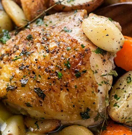 One Pan Roasted Chicken and 40 Cloves of Garlic | Chicken thighs are roasted with garlic, herbs, white wine, potatoes and carrots for an incredibly flavorful one pan meal! | The Chunky Chef | #dinnerrecipe #chicken #roasted #onepan #onepot #easyrecipe
