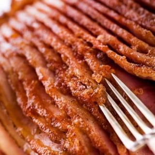 Fork showing the crispy sugar glaze on ham