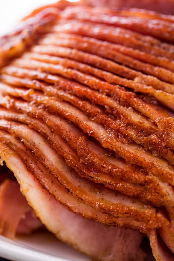 This copycat Honey Baked Ham is juicy and tender, with the most amazing crispy sweet glaze! Made with honey, sugar, and mouthwatering spices, you'll be amazed at how easy it is to make this ham at home and save a TON of money! #holiday #easter #ham #copycatrecipe #hamrecipe #dinner #honeybaked #spiralham