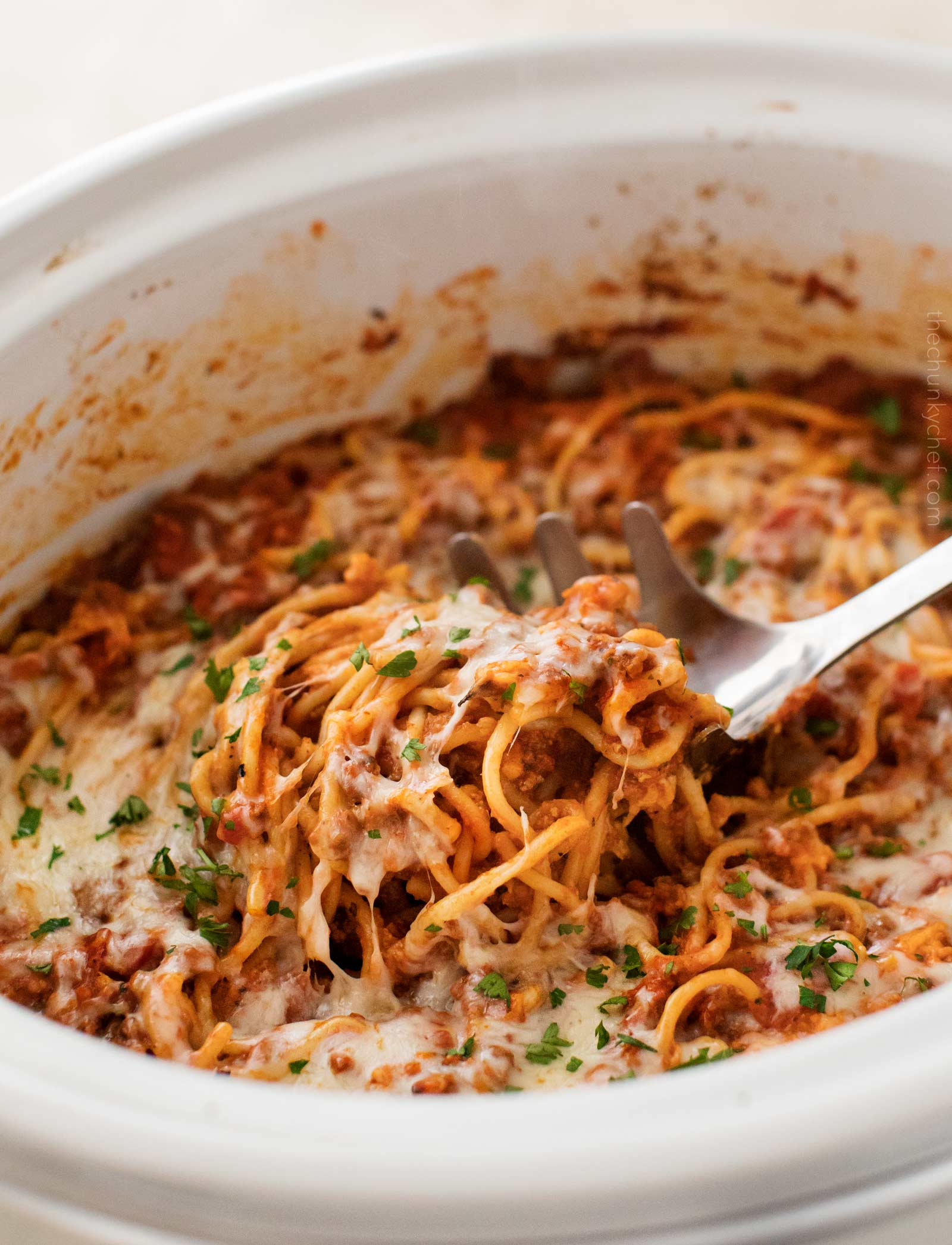 Scoop of crockpot spaghetti casserole