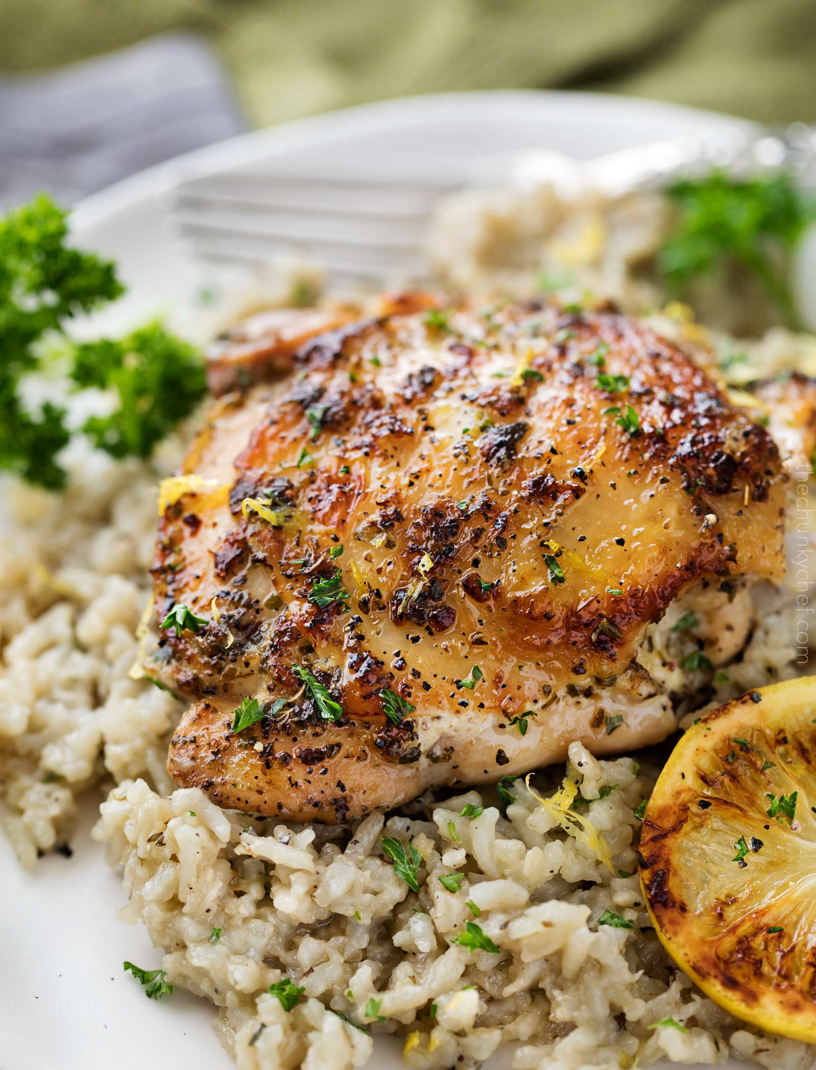 Lemon chicken with Greek rice on plate
