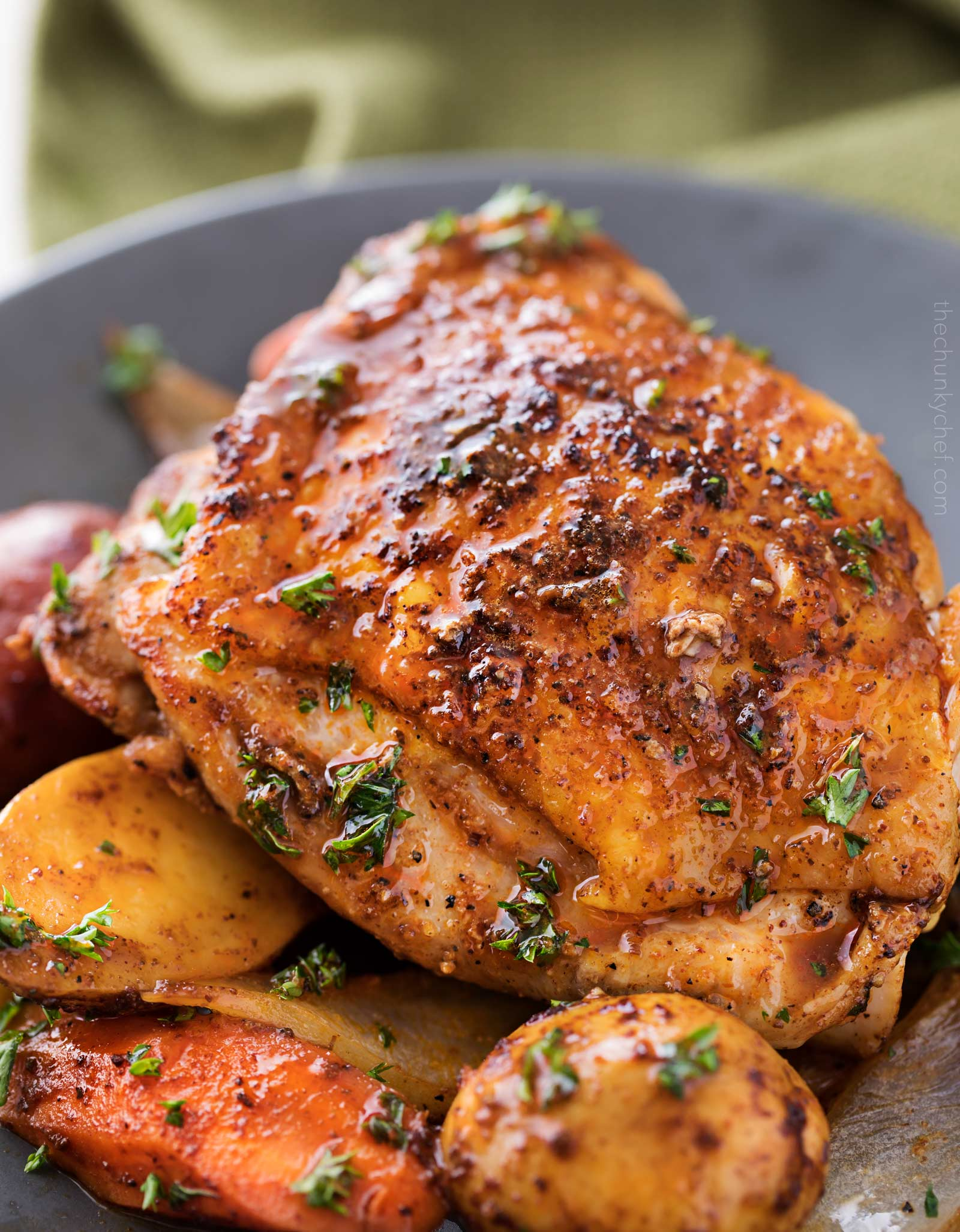 Slow cooker Harissa chicken and vegetables on plate