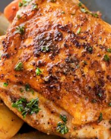This slow cooker Harissa chicken is absolutely brimming with bold, spicy flavors!  Chicken thighs, potatoes, carrots, and onion are slathered in a rich spice mix and then made easily in the crockpot! | #slowcooker #crockpot #chickenrecipes #harissa #weeknightmeal
