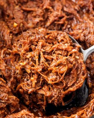 Perfect for a summer cookout or potluck, this shredded beef barbecue recipe is made easily in the crockpot! With a quick and easy homemade barbecue sauce that's sweet and tangy, this beef bbq is truly the best! | #bbq #barbecue #beef #potluck #summer #crockpot #slowcooker