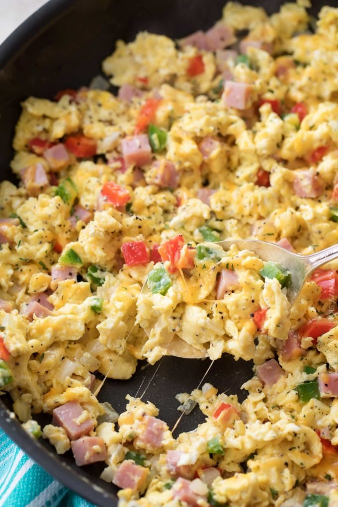 Perfectly fluffy scrambled eggs mixed with sautéed onion, peppers and diced ham, and topped with gooey cheddar cheese.  Perfect for breakfast, brunch or even brinner, and at only 3 weight watchers smart points, it's an amazingly healthy and nutritious recipe!