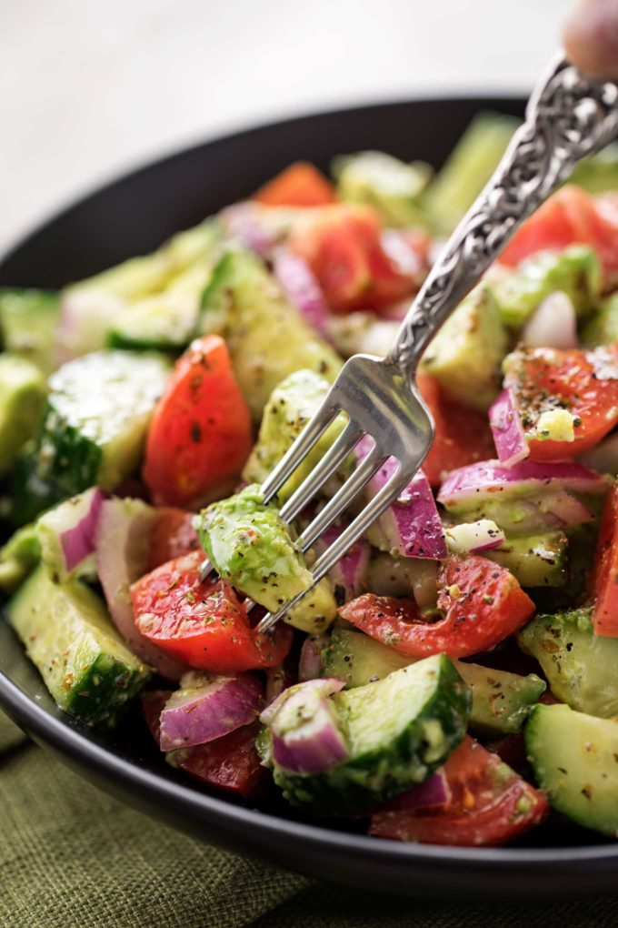 Forkful of tomato avocado salad