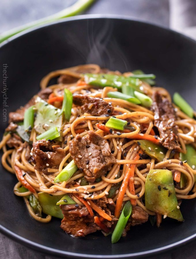 Serving of beef stir fry in black bowl